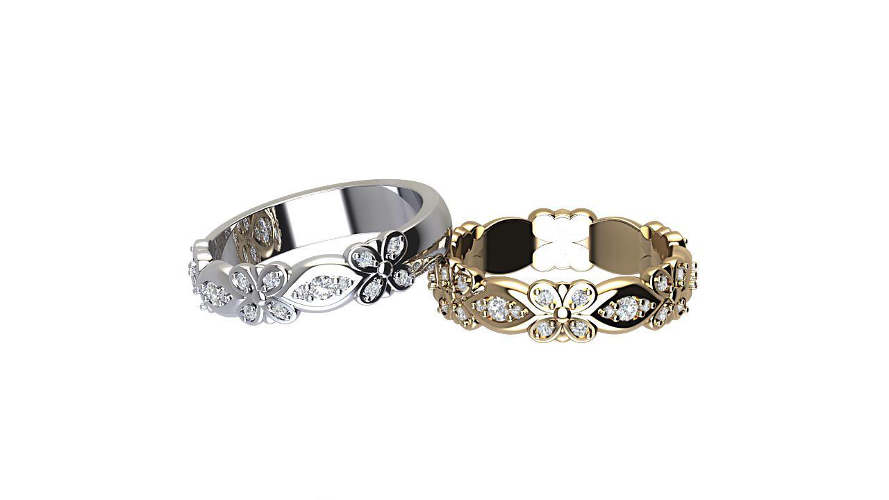 By Oscar round  diamond eternity rings in platinum & 18 carat yellow gold